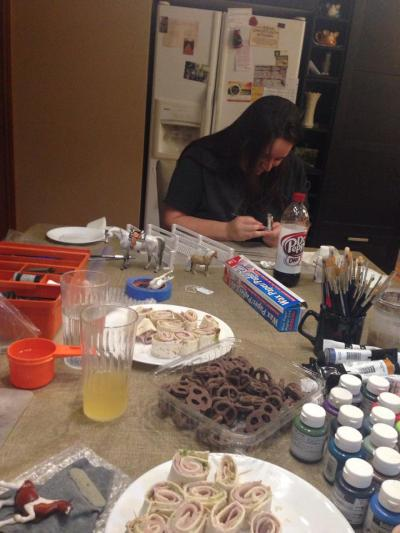 Caryn working on her stablemate Arabian. Also pictured: delicious treats, mimosa, paint, ponies.